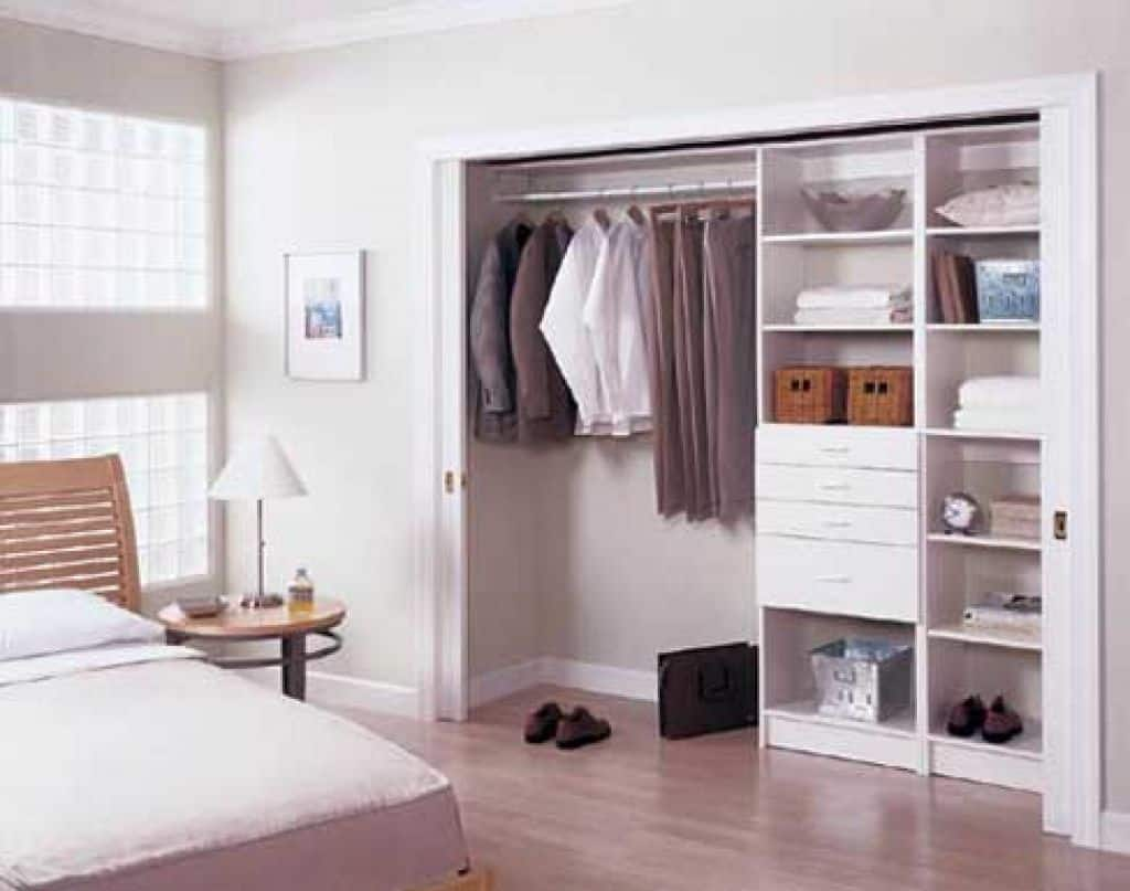 Creating space in your bedroom closet kristina wolf design for Closet de cemento modelos